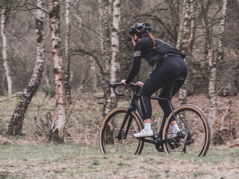 Woman cycling in forest